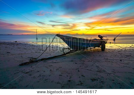 Fisherman boat at Labuan Pearl Of Borneo,Malaysia on 3rd Sept 2016 during beautiful sunset at Labuan tropical island,nature background.