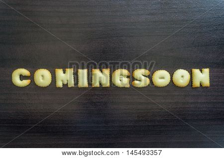 message written with letter biscuits, on wood background / cookie letter on background / creativity word written with homemade biscuits, on wood background