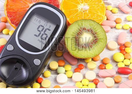 Glucometer With Result, Fruits And Medical Pills, Diabetes, Healthy Lifestyle And Nutrition