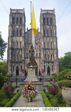 HANOI, VIETNAM - JANUARY 10, 2016: Old catholic cathedral of St. Joseph, cloudy morning. Historical landmark of the city Hanoi, Vietnam