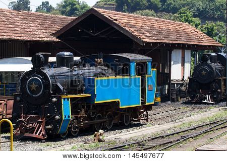 OOTY, TAMIL NADU, INDIA, 22 March 2015 : Nilgiri mountain railway. Blue train. Unesco world heritage. Narrow-gauge. Steam locomotive in depot
