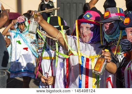 Píllaro ECUADOR - FEBRUARY 6 2016: Unidentified people wearing costumes and masks in diabladas of Pillaro