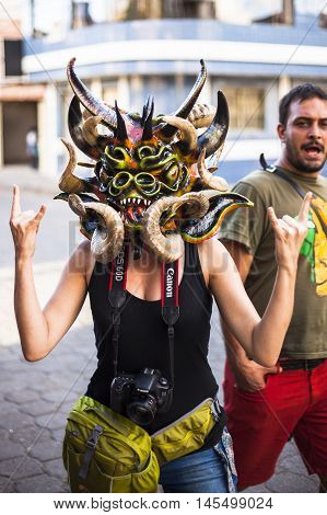 Píllaro ECUADOR - FEBRUARY 6 2016: Unidentified woman dressed as Devil in the diabladas festivities in Pillaro January 6 2016.