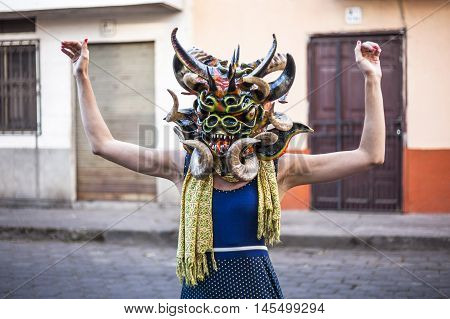 Píllaro ECUADOR - FEBRUARY 6 2016: Unidentified woman dressed as Devil in the diabladas festivities in Pillaro.