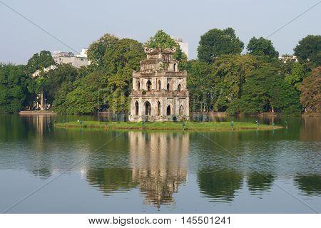 HANOI, VIETNAM - DECEMBER 13, 2015: Turtle Tower on the Lake of the returned sword in the historical centre of Hanoi. Historical landmark