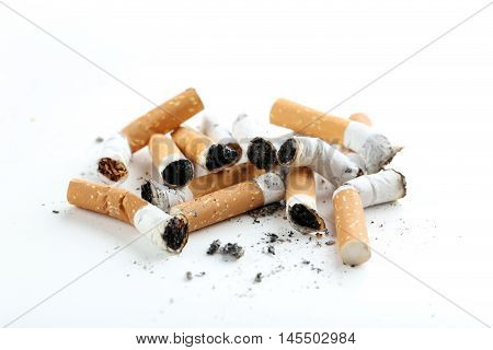 Cigarette Butts With Ash Isolated On A White