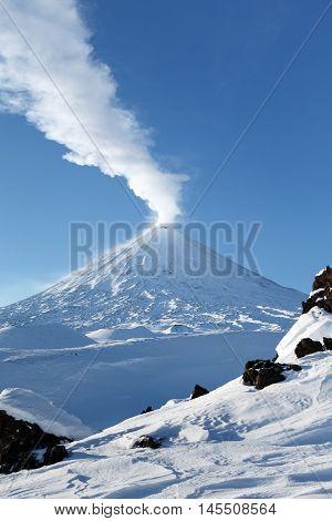 Volcanic landscape of Kamchatka Peninsula: eruption active Klyuchevskaya Sopka (Klyuchevskoy Volcano). Eurasia Russian Federation Far East Kamchatka Region Klyuchevskaya Group of Volcanoes.