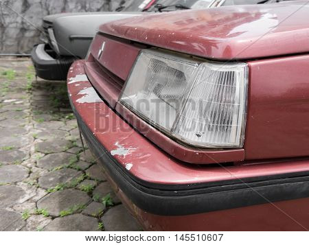 Close up of the front headlight of old car