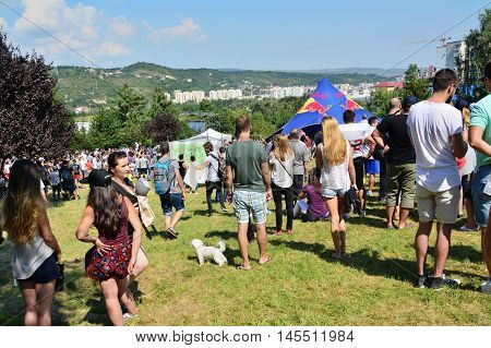 CLUJ-NAPOCA ROMANIA - SEPTEMBER 3 2016: People relaxing and socializing outdoors at the Red Bull Soapbox Race.