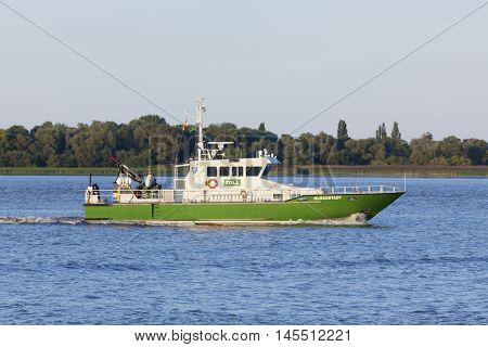 Stade, Germany - August 30, 2016: German customs boat GLUECKSTADT on Elbe river.