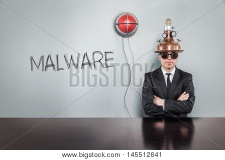 Malware text text with vintage businessman and alert light