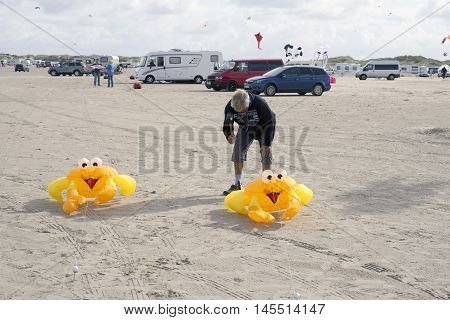 LAKOLK DENMARK - SEPTEMBER 3 2016: Colorful yellow crab kites on the big beach on Lakolk Romo. International Kite Festival for the 27th time. September 3 2016.
