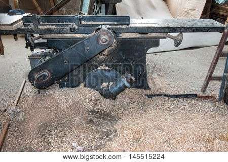Old and used planing machine in the joinery workshop
