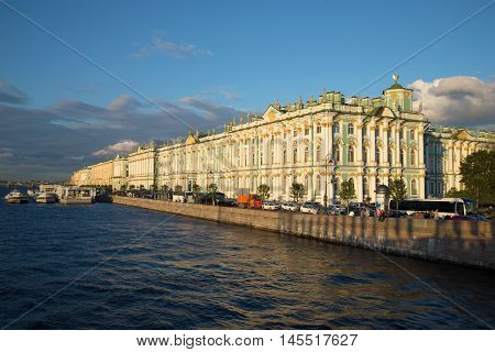 ST. PETERSBURG, RUSSIA - AUGUST 09, 2016: View of the Winter Palace from the Palace Bridge, August evening. Historical landmark of the city St. Petersburg