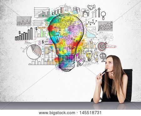 Portrait of businesswoman sitting near concrete wall with colorful light bulb sketch and diagrams. Concept of statistician work