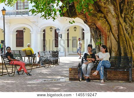 SANTO DOMINGO, DOMINICAN REPUBLIC - January 24, 2016: Street life and view of Calle el Conde and Columbus Park of Santo Domingo.