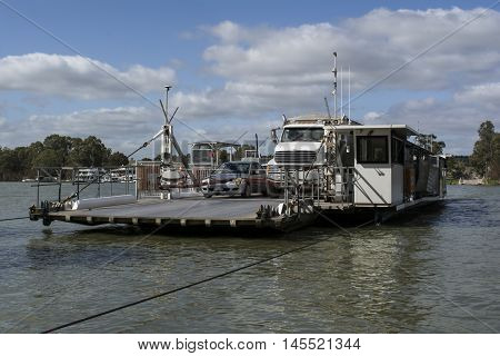 Mannum South Australia Australia, Australia - Aug 13 2016: Vehicles transported on the ferry at Mannum on the Murray River South Australia