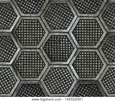 Seamless texture of factory floor made of hexagonal cast iron tiles. Dirty dark and old style.