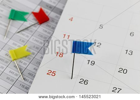 Blue Pins to Wildcats on the calendar beside the number of twenty five in business concept time and date.