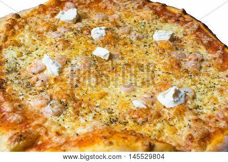 Pizza with shrimp cream fraiche cheese tomatoes and Pesto Sauce.