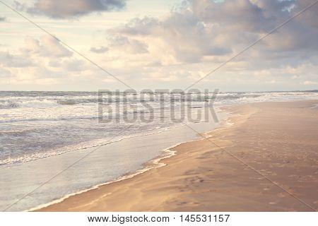 Warm summer sunset on the sea beach