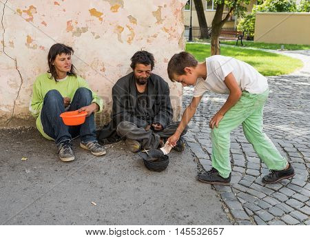 Uzhhorod, Ukraine -  August 21, 2016: Poor People Begging For Alms Near The Church