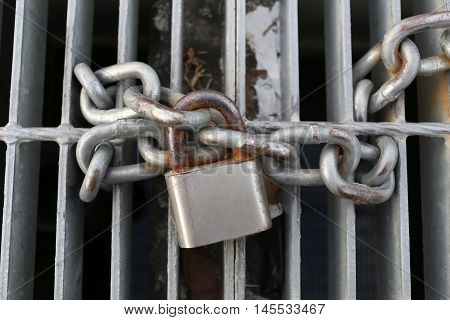 old padlock chain lock a safety concept.