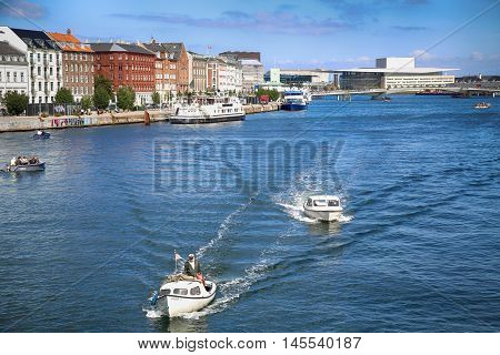 Copenhagen Denmark - August 15 2016: View on people with boats and The Copenhagen Opera House from Knippelsbro bascule bridge in Copenhagen Denmark