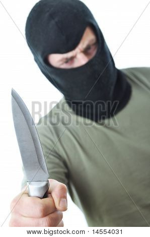 Bandit In Balaclava With Knife Isolated
