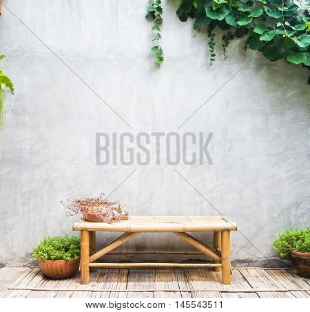 Chairs placed on bamboo background with lime green plants Lough.