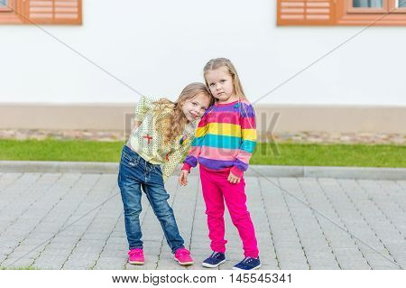 Two Beautiful Girlfriends Posing In The Garden