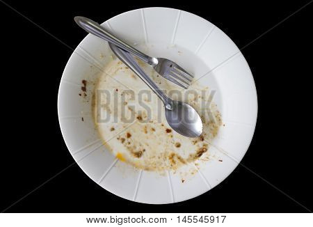 Rice dishes after eating isolated black background.