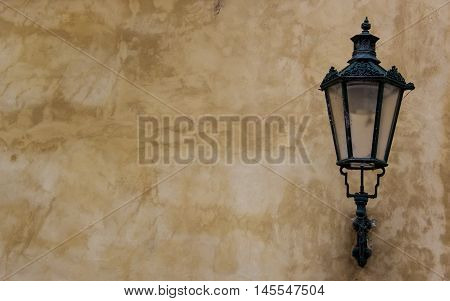 Old street lantern lamp on wall. Copy space