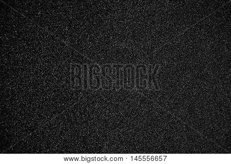 Black textured background - Sandpaper texture for Backdrop. Abstract rough sandpaper sheet close up for banner poster ad template design