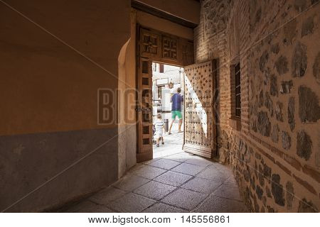 Tourists crossing an old passageway Toledo city Spain