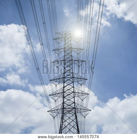 Electricity Transmission Lines And Pylon Silhouetted Against Blue Sky And Cloud,high Voltage Tower ,