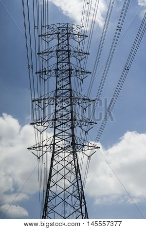 Electricity Transmission Lines And Pylon Silhouetted Against Blue Sky And Cloud,high Voltage Tower