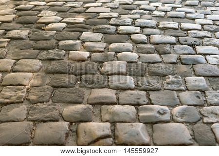 Abstract   urban texture background of cobblestone pavement.