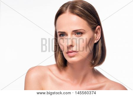 Healthy beauty. Wistful young woman beauty portrait on isolated white background