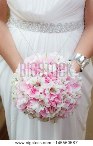 White and pink wedding bouquet of hydrangea and alstroemeria flowers