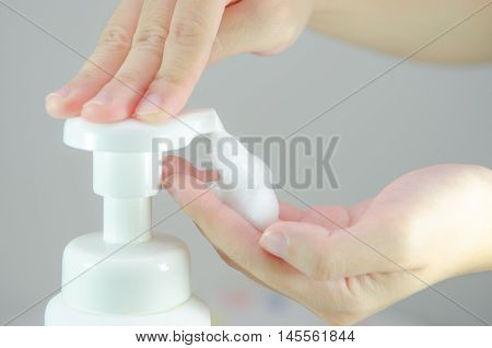 Putting whip foam soap on the hand.
