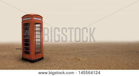 Lone phone booth standing in the desert.