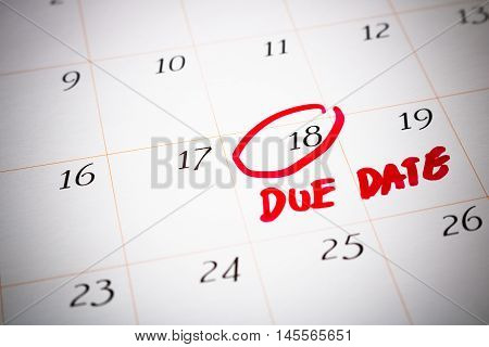Due Date day the 18th Red circled mark on a white calendar as a reminder of the date your project must be submitted or the date you expect to deliver your babyselective focus on number 18