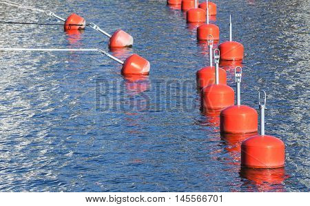 Small Red Mooring Buoys In A Row