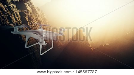 Photo White Matte Generic Design Modern Remote Control Drone action camera Flying in Sky under Earth Surface. Grand Canyon Sunset Background. Horizontal, back top angle view.Film Effect. 3D rendering
