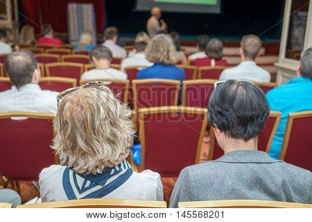 Business Conferences Concept And Ideas. Male Professional Lecturer Speaking In Front Of The Group Of