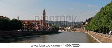 Adige river bridge view in Verona in sunny day Italy