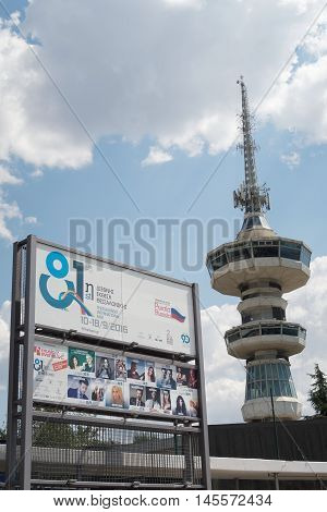 Thessaloniki, Greece - September 04 2016: 81st International fair entrance sign. 81st Thessaloniki International Fair takes place from 10 to 18 September 2016. OTE telecommunications tower is visible.