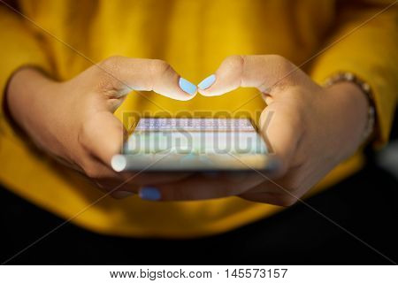 Woman Typing Phone Message On Social Network At Night