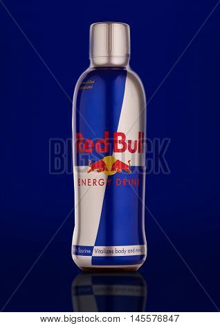 LONDON UNITED KINGDOM-SEPTEMBER 3 2016: Bottle of Red Bull Energy Drink. In terms of market share Red Bull is the most popular energy drink in the world.On blue background.
